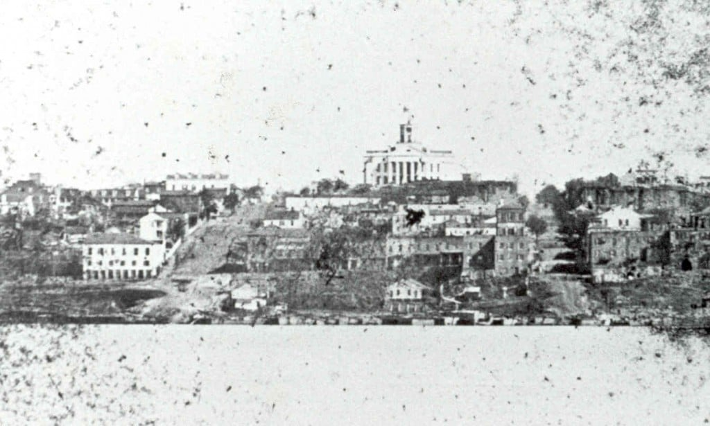 """Vicksburg Circa 1860 This photograph is one of the earliest known views of the Hill City. Founded by the Reverend Newit Vick in 1819 and incorporated in 1825, by 1860 Vicksburg was a major transportation hub that catered to steamboats and the railroad.Boats left daily providing connections to the major towns in the Mississippi River Valley, and rail service linked the city with Monroe, Louisiana to the west and Jackson, Mississippi to the east.In 1860 Vicksburg had a population of 4600 and was the second largest city in the state after Natchez. The rugged hills of Vicksburg made the city a natural defensive point on the Mississippi River.One Union soldier on seeing the terrain for the first time wrote his sister, """"Tis the opinion of all that Vicksburg is the strongest fortified place in the Confederacy."""""""