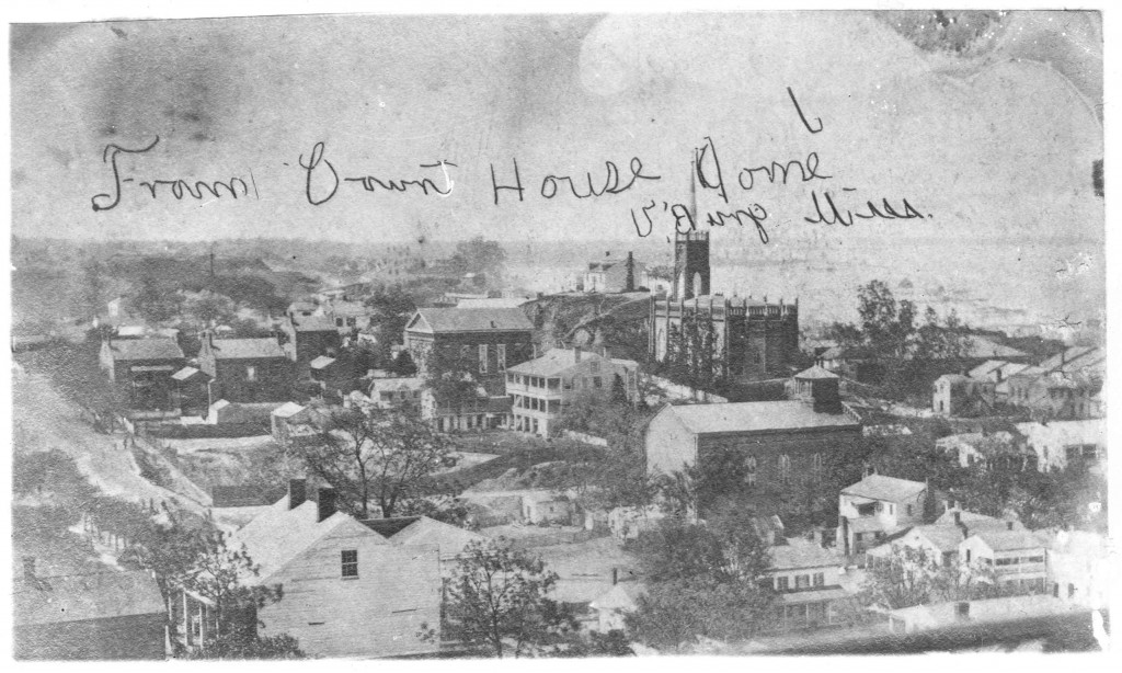 View of Vicksburg taken from the top of the Court House looking to the southwest.  In the distance with the tall spire is St. Paul's Catholic Church, and just opposite on the lofty   prominence was the home Sky Parlor Hill, known for it's wonderful view. During the siege   citizens went there at night to watch the Union shells in flight over the city.    Watching the action from Sky Parlor Hill was exciting, but it could also be dangerous: