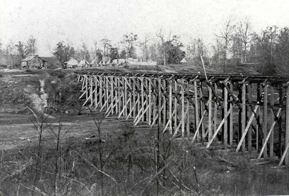 Four Mile Bridge on the Southern Railroad, four miles east of Vicksburg, circa 1864. Note the Union soldiers camped on the far side of the bridge.