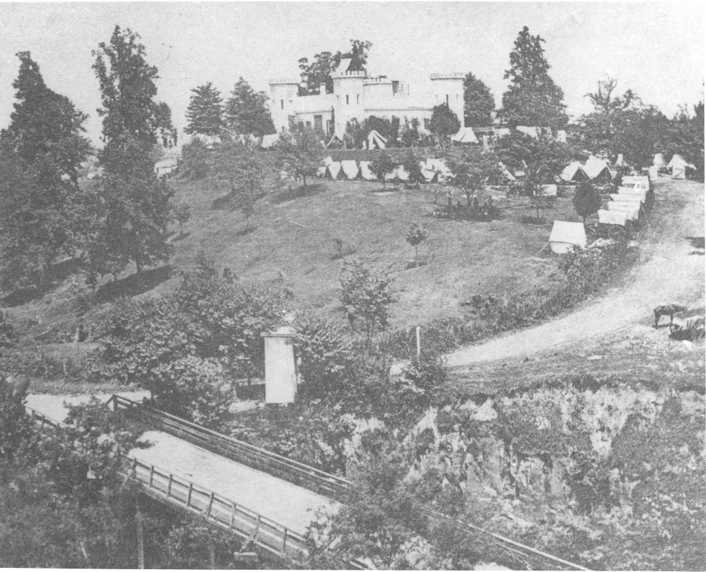 "One of the most unique homes in Vicksburg – The Castle, circa 1863.  Note the Union soldiers camped on the lawn.    Constructed in the early 1850's by Thomas Robbins, the Castle was one of the most interesting homes in Vicksburg. Built like a real castle, the home boasted a moat and was surrounded by an Osage Orange Hedge. In 1859 the home was sold to Armistead Burwell, an outspoken Unionist. Burwell was an outcast in Vicksburg because of his views and once wrote a friend, ""I dare not go any place in the interior (would be hung or imprisoned if I did). Despite his allegiance to the United States, after the siege the Federals destroyed Burwell's home and built an artillery battery on the site, known appropriately enough as the Castle Battery."