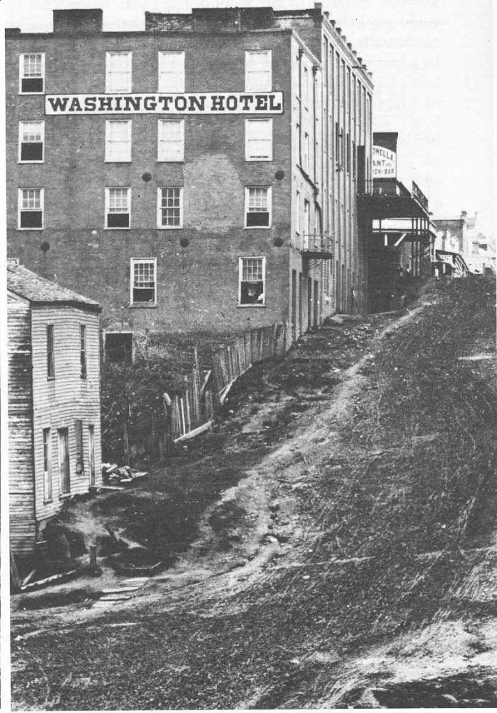View of China Street showing the Washington Hotel, circa 1876. During the siege the building was pressed into service as a hospital. Reverend William Lovelace Foster, Chaplain of the 35th Mississippi Infantry, spent time in the Washington Hotel ministering to sick and wounded soldiers. He wrote of the hotel, It was comparatively secure from those troublesome mortar shells – for the most of them passed over & it was too far from our lines to be disturbed by firing from that direction. Dr. Whitfield with several assistants attended to the invalids. All the rooms were soon crowded with the sick & dying – Some in bunks & some upon the floor. Everything was conducted as well as possible but O the horrors of a hospital!