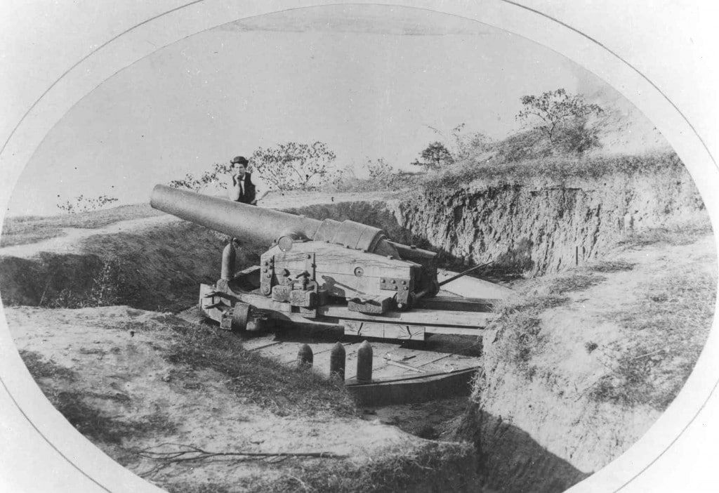 A Double-Banded Brooke Rifle in the Vicksburg river defenses, taken after the siege.  There were two Brooke Rifles in the river batteries, a 6.4 inch gun in the appropriately  named Brooke Battery, located in the southern part of the city, and a 7 inch gun in Battery Five in the northern part of town.    The Brooke Rifle was invented by Confederate naval officer John M. Brooke, and were produced in two locations: Tredegar Foundry in Richmond, Virginia, and the Confederate Naval Ordnance Works in Selma, Alabama.  The fire from the 7-inch Brooke, manned by cannoneers of the 1st Tennessee Heavy Artillery, played an important role in helping to sink the U.S.S. Cincinnati.