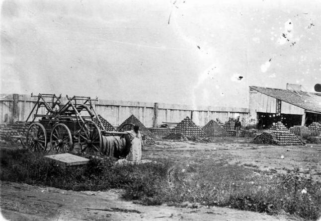 """Captured Confederate Ordnance at Vicksburg, Circa 1864. Along with the artillery, the Federals captured 38,000 artillery projectiles, 58,000 pounds of powder, and 4,800 artillery cartridges.In 1864 a reporter from the Vicksburg Daily Herald toured the Federal Ordnance Department and wrote, """"We then visited the yard in which are piled over one hundred thousand cannon balls, shot and shell, of different kinds."""""""