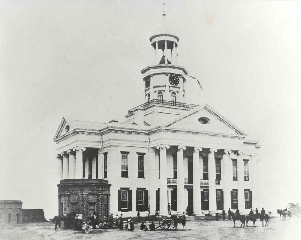 Union Soldiers on the lawn of the Warren County Courthouse after the siege. Note the cupola support column on top of the clock tower with a large chunk removed by a shell fragment. On July 4, 1863, the victorious Union Army marched into Vicksburg, and the United States flag was raised over the courthouse.Having to surrender was bad enough, but doing it on Independence Day made things worse for the citizens, and they didn't forget the pain of surrender.The city did not celebrate the holiday again for 82 years – July 4, 1945, at the end of World War II was the next official celebration in Vicksburg. We suppose it is well enough to remind the absent-minded reader the Fourth of July puts in an appearance this morning, the day on which the Continental Congress at Philadelphia adopted the Declaration of Independence...In old times it was customary to celebrate the day with considerable pomp and spread-eagle vaporing; but now, in this unfortunate section where the great natural rights of safety, life, liberty, and property have been almost swept away by our bayonet rulers, but few are found to do the occasion reverence. Vicksburg Herald, July 4, 1872