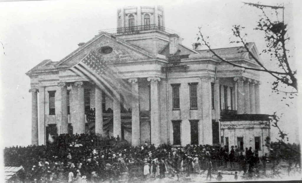"Unidentified gathering on the courthouse lawn, circa 1865.    On seeing the United States flag flying over the courthouse, Unionist Dora Miller wrote, ""Now I feel once more at home in mine own country.""    More typical was the reaction of Alice Shannon, who wrote to her sister that she could see ""that hateful flag flying from the Court House Hill."""