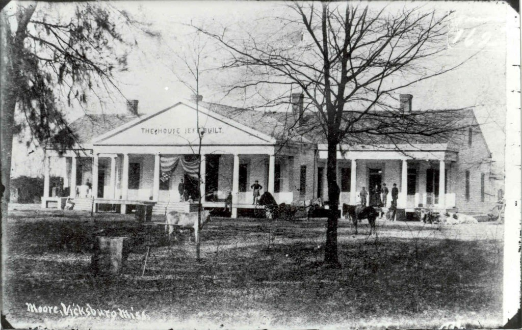 "Union Soldiers at Brierfield, Jefferson Davis' home south of Vicksburg, Circa 1864. Note the sign the soldiers erected over the front door, ""The House Jeff Built."" According to a newspaper<br />account, there was another sign over the back door saying, ""Exit Traitor.""<br />The ""Jeff Place"" is also a very fine plantation. The residence has not been injured, except the door locks and one or two marble mantels broken up, apparently for trophies. The Jeff furniture has been removed, but the rooms are still furnished with furniture brought here.<br />Vicksburg Daily Herald, 6 July 1864"
